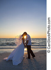 Bride and Groom Marriage Kissing Sunset Beach Wedding