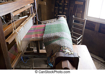Loom - Antique weaving loom inside an old mill in central...