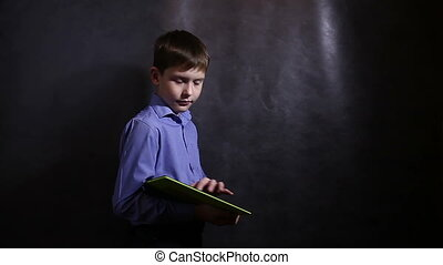 Teenage boy playing on black background plate - Teenage boy...