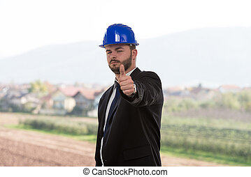Young Construction Manager Showing Thumbs Up