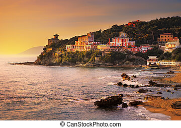 Castiglioncello sunset on cliff rock and sea. Tuscany,...