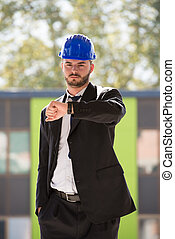 Handsome Construction Manager Looking At His Watch -...