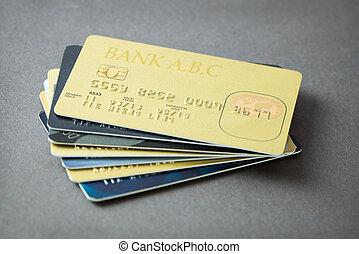 Credit cards - Stack of credit cards over grey background