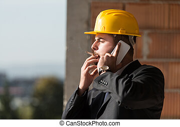 Businessman Talking On Phone And Smoking A Cigar - Young...