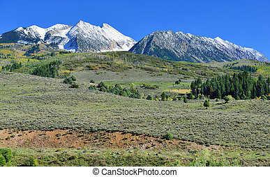Alpine scenery and snow covered mountains during foliage...