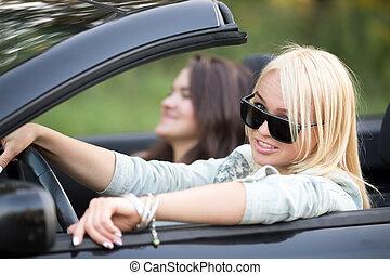 Friends riding luxury car - Portrait of beautiful confident...
