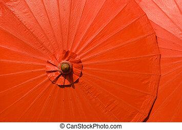 Orange cotton umbrellas in Thailand - Orange cotton...