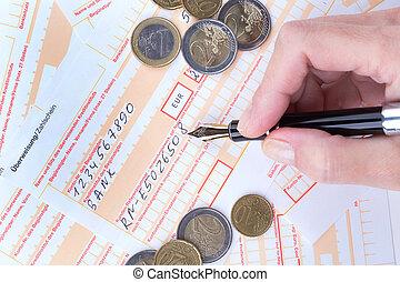 female hand filling Remittance slip - female hand filling...