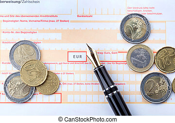 Fountain Pen on empty Remittance slip with coins