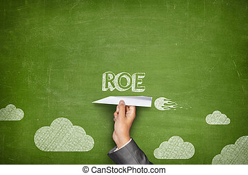 ROE concept on blackboard with paper plane - ROE concept on...