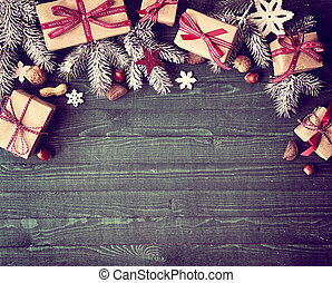Seasonal rustic Christmas border composed of decorative...