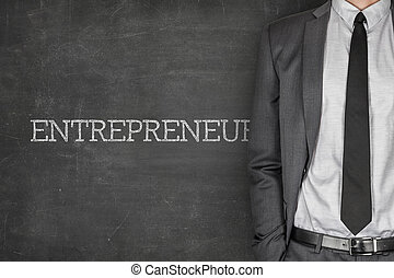 Entrepreneur on blackboard with businessman in a suit on...
