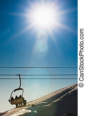 chairlift - group of people on chairlift in France. Copy...
