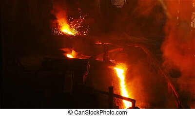 Stream of molten metal - Molten metal melted in furnace at...