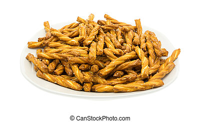 Braided pretzel sticks in a dish - A dish filled with...