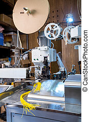 Manufacturing facility Crimped wires on machine -...
