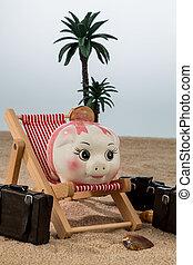 piggy bank in a deckchair - a piggy bank is in a deckchair....