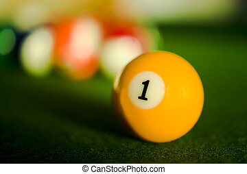 First number - Close-up shot of a billiard balll on a green...