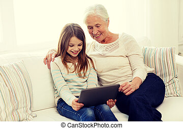 smiling family with tablet pc at home - family, generation,...