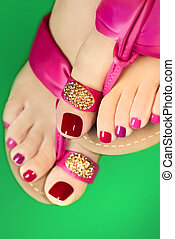 Pink pedicure. - Pedicure with different colors of paint on...