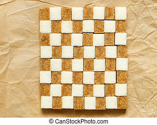 Chessboard from lump sugar on paper