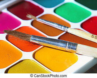 Water colour paints and brushes close up