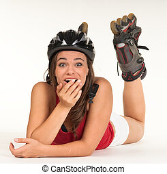 young girl with inline skates