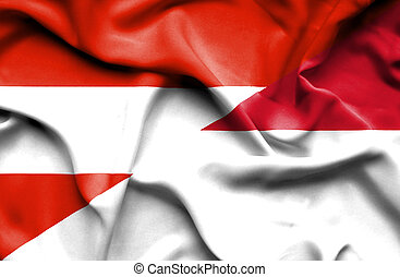 Waving flag of Indonesia and Austria
