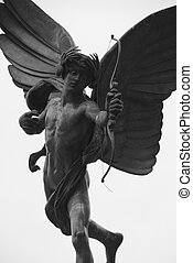 Cupid in Picadilly Circus - Cupid, isolated with white...