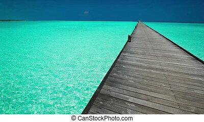 Wooden long jetty in Maldives - Wooden long jetty over...