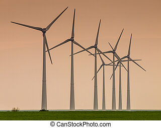 Row of windturbines at sunset - Row of windturbines on the...
