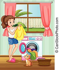 Woman doing laundry in the house