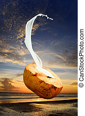 Coconut water spurt with a pink sky background