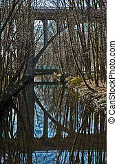 Arch reflection - Overpass arching over the canal on the...