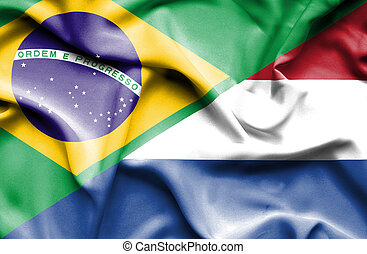 Waving flag of Netherlands and Brazil