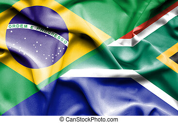 Waving flag of South Africa and Brazil