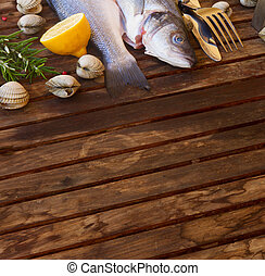 Seabass - Two Seabass raw fish with shellfish, copy space on...
