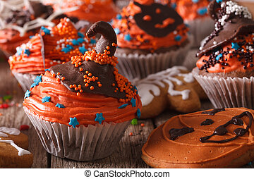 festive Halloween cupcakes with chocolate witches hat close-up