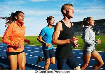 Group of multiracial professional runners practicing - Group...