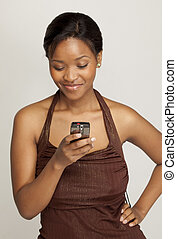 Young woman texting - Young South African woman sending a...