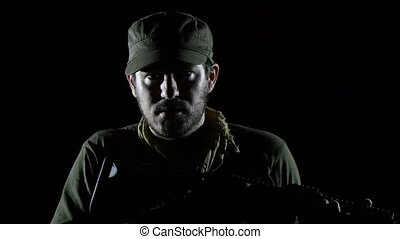 Bearded Soldier With Rifle  in the Dark Aiming  in the Camera