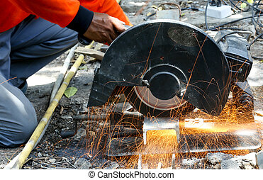 worker cutting metal with saw disk - Industrial worker...