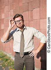 Hipster businessman outdoors - Hipster businessman with look...
