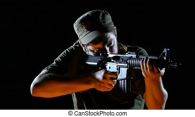 Terrorist With Rifle Looking for Enemies in the Dark -...