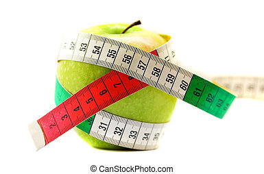 Diet concept. Ripe green apple with measuring tape
