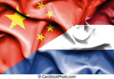 Waving flag of Netherlands and China