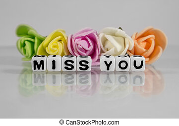 Miss you text with flowers