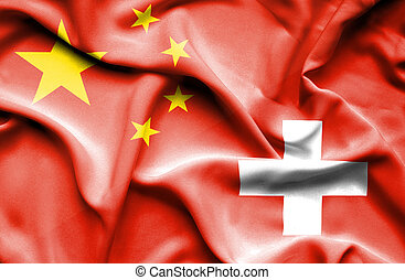 Waving flag of Switzerland and China