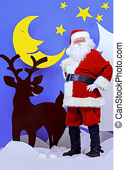 old person - Santa Claus standing with a reindeer in a...