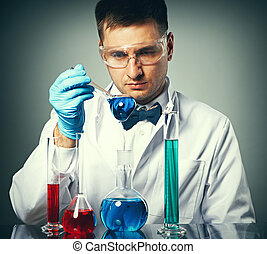 Scientist at laboratory - Scientist in protective glasses at...